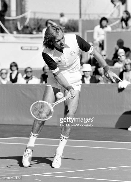 John Lloyd of Great Britain returns the ball against John McEnroe of the United States in the 1st rubber of the 1978 Davis Cup Final at the Mission...