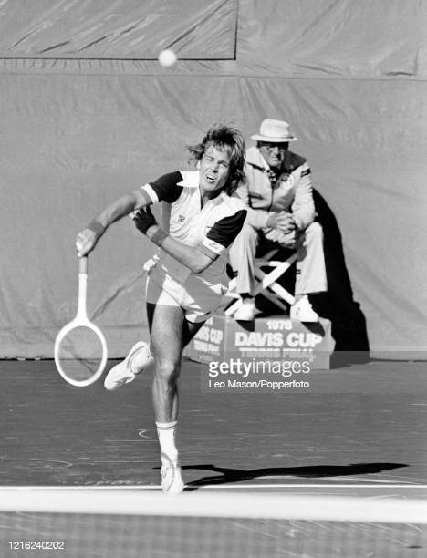 John Lloyd of Great Britain serves against Brian Gottfried of the United States in the 5th rubber of the 1978 Davis Cup Final at the Mission Hills...