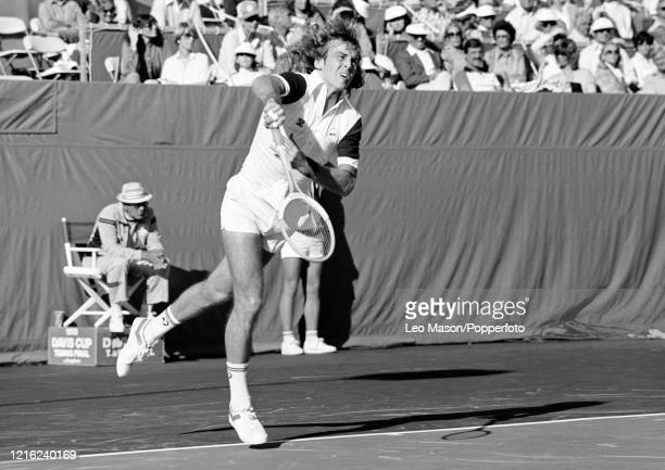John Lloyd of Great Britain serves against John McEnroe of the United States in the 1st rubber of the 1978 Davis Cup Final at the Mission Hills...