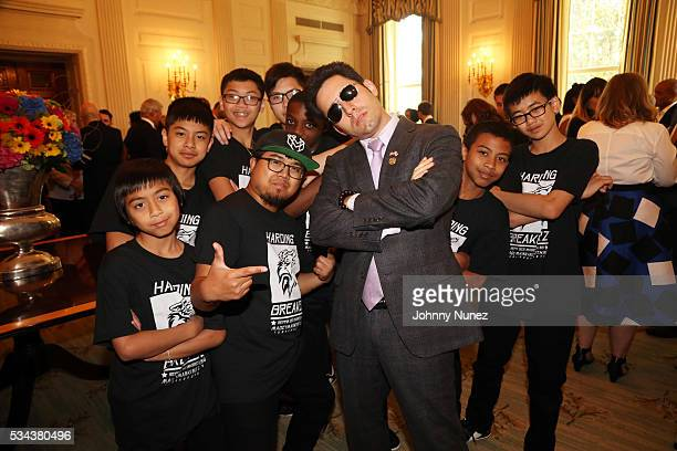 John Lloyd Young poses with Turnaround Arts participants at the White House Turnaround Arts Talent Show 2016 at The White House on May 25 in...
