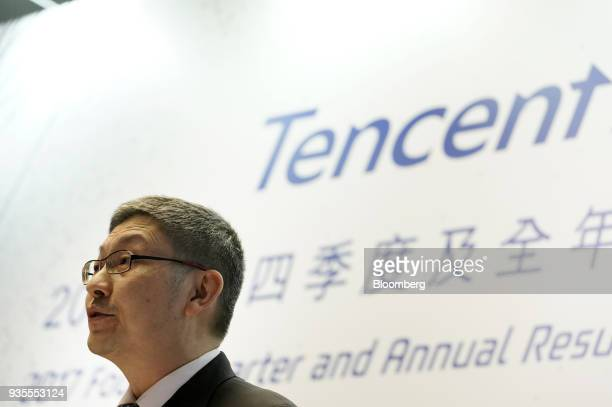 John Lo chief financial officer of Tencent Holdings Ltd speaks during a news conference in Hong Kong China on Wednesday March 21 2018 Tencent...