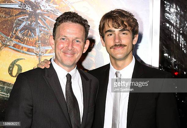 John Logan and guest attend the 'Hugo' premiere at the Ziegfeld Theatre on November 21 2011 in New York City