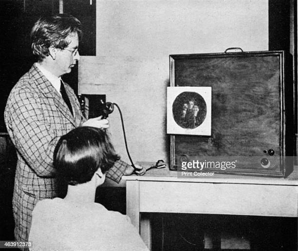 John Logie Baird , Scottish electrical engineer and pioneer of television, 1920s. Baird in front of an early television transmitter. Baird began...