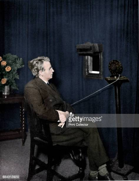 John Logie Baird , Scottish electrical engineer and pioneer of television, 1920s. Baird giving an early television demonstration. The image is of...