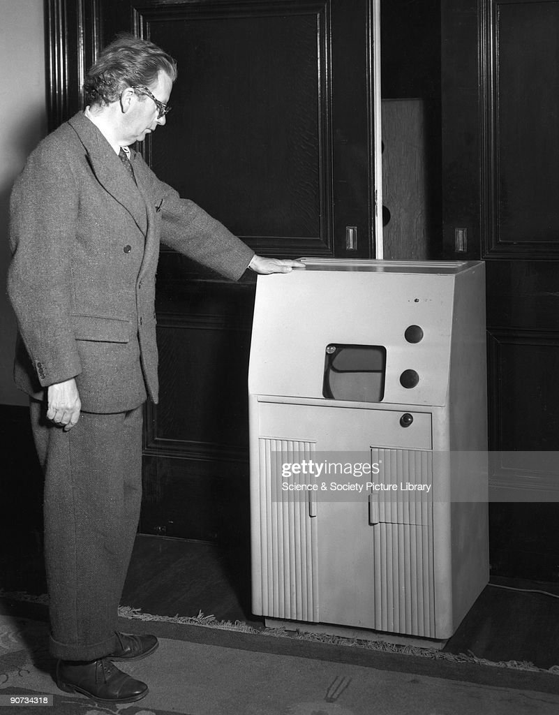 John Logie Baird (1888-1946), television pioneer, August 1942. John Logie Baird (1888-1946), television pioneer, August 1942. After a serious illness in 1922, Baird devoted himself to experimentation and developed a crude TV apparatus, able to transmit a picture and receive it over a range of a few feet. The first real demonstration was within two attic rooms in Soho, London, in early 1926, and by 1927 he had managed to transmit pictures by telephone line from London to Glasgow. Baird with his medium-sized cabinet model television which could receive BBC, stereoscopic and colour television. The colour filter on this model could be removed as desired.