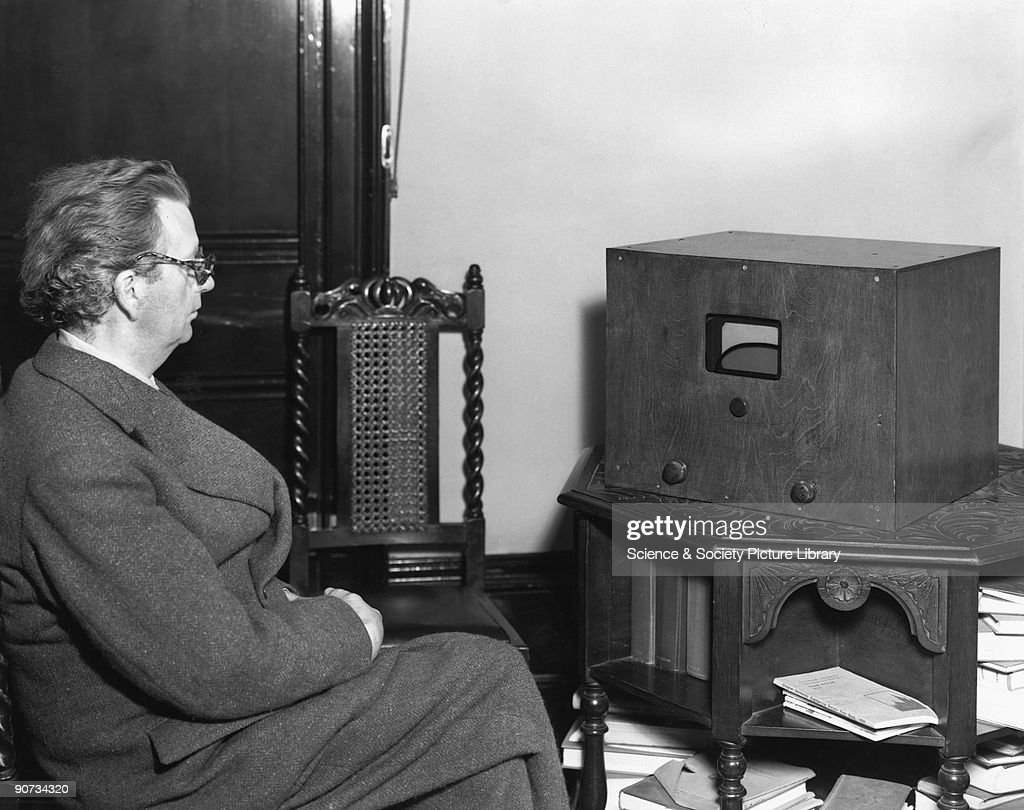 John Logie Baird (1888-1946), television pioneer, August 1942. John Logie Baird (1888-1946), television pioneer, August 1942. After a serious illness in 1922, Baird devoted himself to experimentation and developed a crude TV apparatus, able to transmit a picture and receive it over a range of a few feet. The first real demonstration was within two attic rooms in Soho, London, in early 1926, and by 1927 he had managed to transmit pictures by telephone line from London to Glasgow. Baird with his table receiver for BBC, monochrome, stereoscopic and colour television. The television had a five inch screen, and the dark line across the screen shows the division between orange-red and blue-green sectors. Baird is wearing coloured spectacles to view a stereoscopic picture.