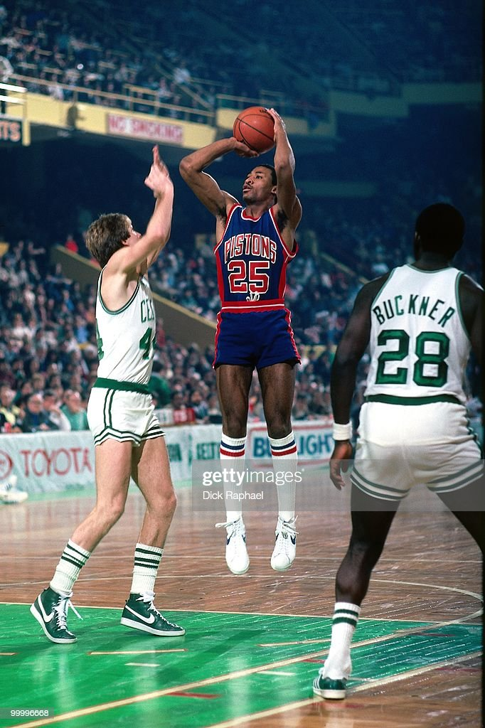 John Long #25 of the Detroit Pistons shoots a jump shot against Danny Ainge #44 of the Boston Celtics during a game played in 1983 at the Boston Garden in Boston, Massachusetts.