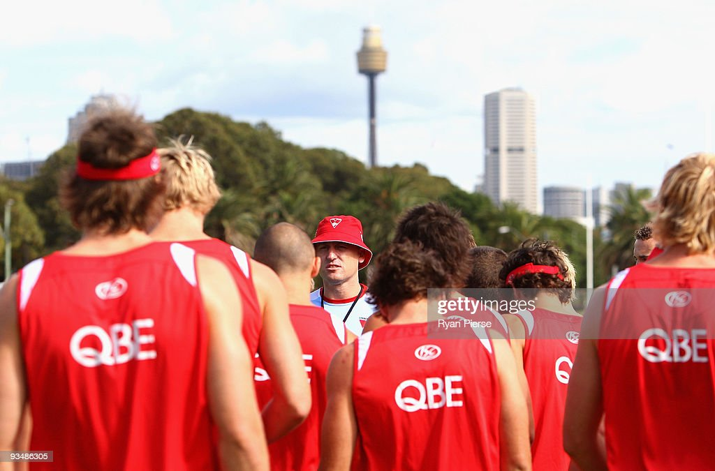 John Longmire (C), assistant coach of the Swans talks his players during a Sydney Swans Training Session at Lakeside Oval on November 30, 2009 in Sydney, Australia.