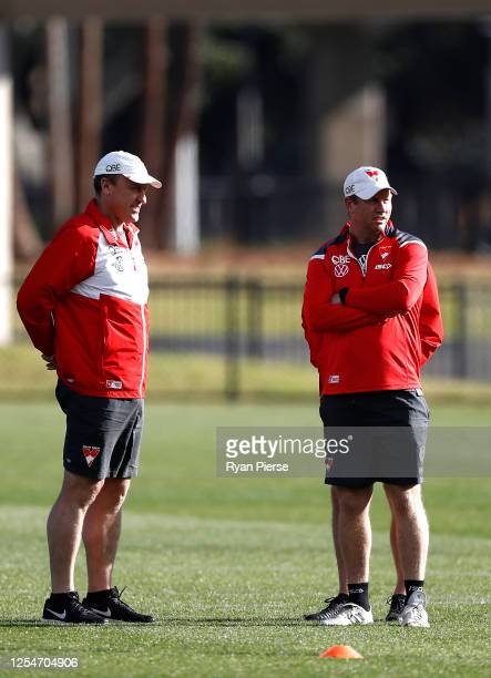 John Longmire coach of the Swans and Swans assistant coach Steve Johnson look on during a Sydney Swans AFL training session at Lakeside Oval on July...