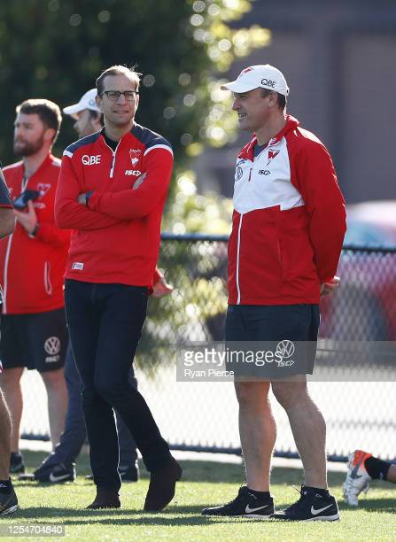 John Longmire coach of the Swans and Swans Head of Football Charlie Gardiner look on during a Sydney Swans AFL training session at Lakeside Oval on...
