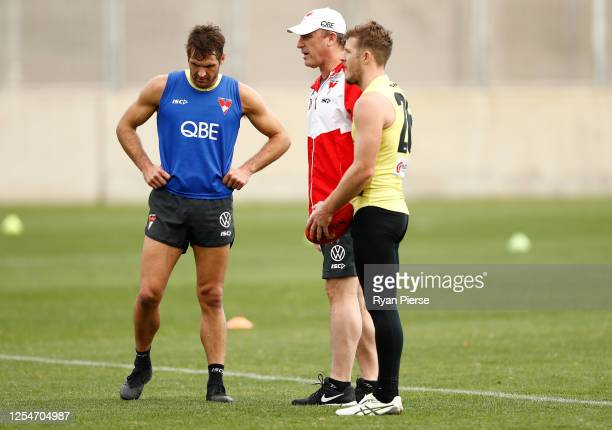 John Longmire coach of the Swans speaks with Josh Kennedy and Luke Parker of the Swans during a Sydney Swans AFL training session at Lakeside Oval on...