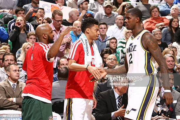 John Lucas III and Diante Garrett of the Utah Jazz greet teammate Marvin Williams during play against the Oklahoma City Thunder at EnergySolutions...