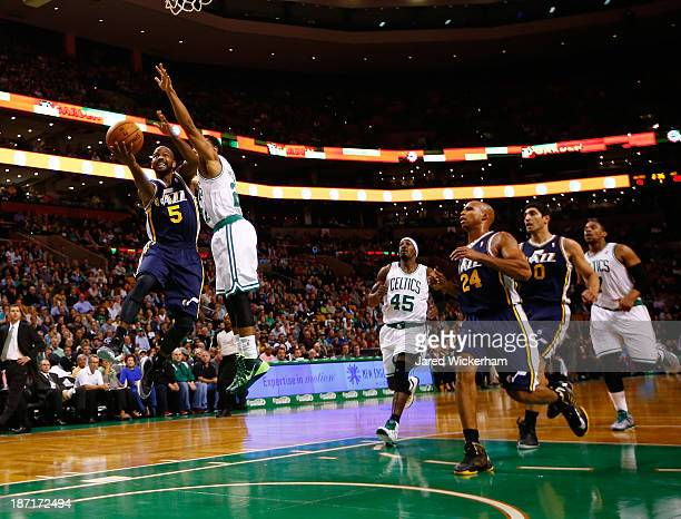 John Lucas III drives to the basket against Phil Pressey of the Boston Celtics in the first quarter at TD Garden on November 6 2013 in Boston...