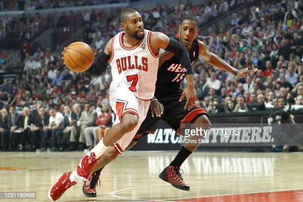 John Lucas III of the Chicago Bulls drives to the basket during the game against the Miami Heat on March 14, 2012 at the United Center, Chicago,...