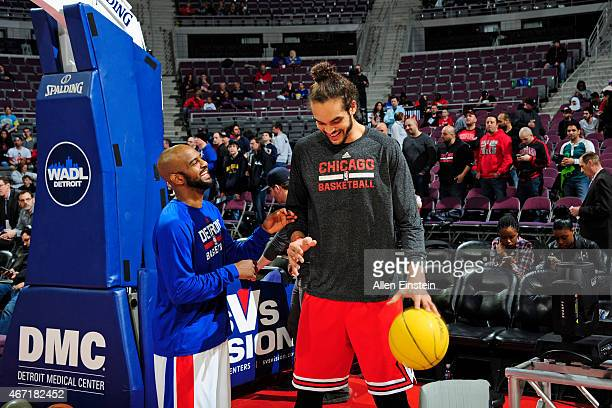 John Lucas III of the Detroit Pistons and Joakim Noah of the Chicago Bulls before the game on March 21 2015 at The Palace of Auburn Hills in Auburn...