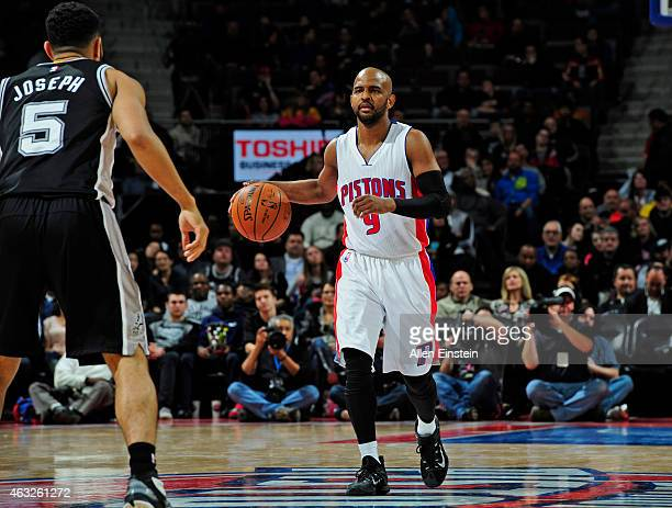 John Lucas III of the Detroit Pistons dribbles the ball against the San Antonio Spurs on February 11, 2015 at The Palace of Auburn Hills in Auburn...