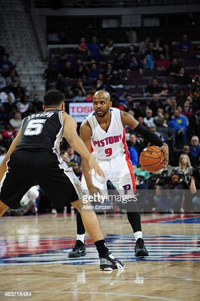 John Lucas III of the Detroit Pistons handles the ball against the San Antonio Spurs on February 11, 2015 at Palace of Auburn Hills in Detroit,...