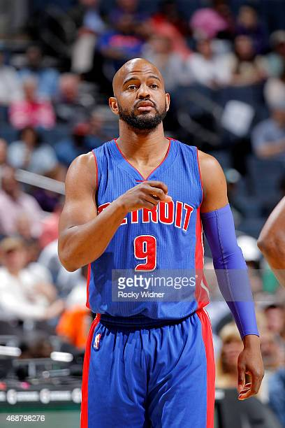 John Lucas III of the Detroit Pistons looks on during the game against the Charlotte Hornets on April 1 2015 at Time Warner Cable Arena in Charlotte...