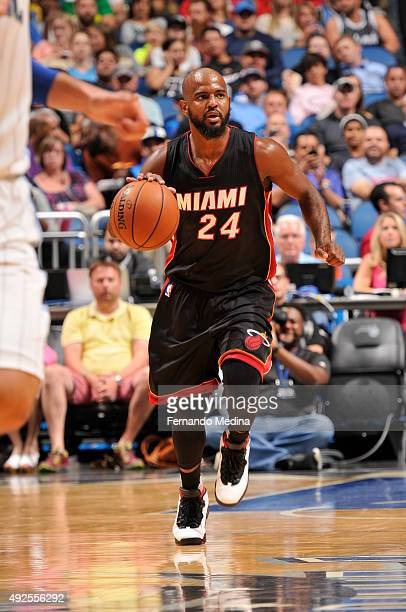 John Lucas III of the Miami Heat drives to the basket against the Orlando Magic during a preseason game on October 13 2015 at Amway Center in Orlando...