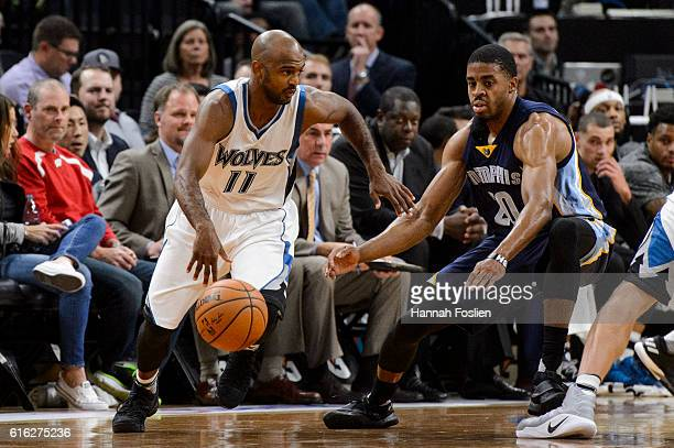 John Lucas III of the Minnesota Timberwolves dribbles the ball against D.J. Stephens of the Memphis Grizzlies during the preseason game on October...