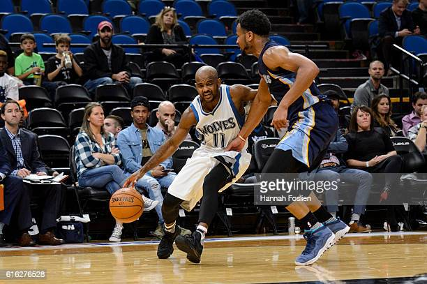 John Lucas III of the Minnesota Timberwolves drives to the basket against Chris Crawford of the Memphis Grizzlies during the preseason game on...