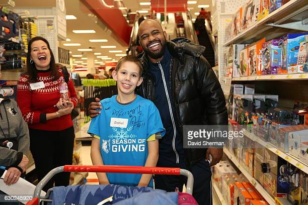 John Lucas III of the Minnesota Timberwolves goes shopping for holiday gifts with kids who are up for adoption through the Minnesota Timberwolves...