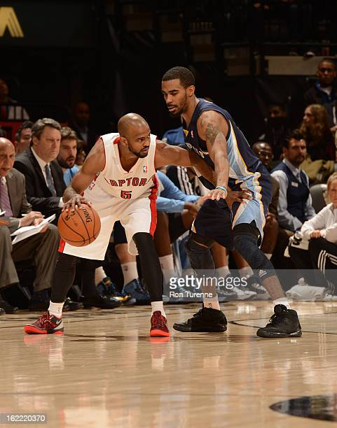 John Lucas III of the Toronto Raptors controls the ball against Mike Conley of the Memphis Grizzlies on February 20, 2013 at the Air Canada Centre in...