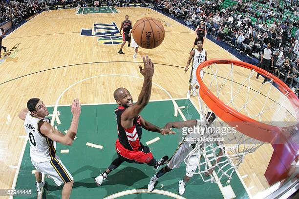 John Lucas III of the Toronto Raptors shoots against Enes Kanter of the Utah Jazz at Energy Solutions Arena on December 07, 2012 in Salt Lake City,...