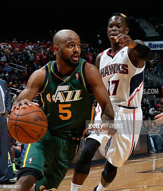 John Lucas III of the Utah Jazz against Dennis Schroder of the Atlanta Hawks at Philips Arena on December 20 2013 in Atlanta Georgia NOTE TO USER...