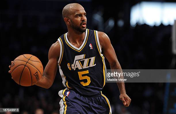 John Lucas III of the Utah Jazz carries the ball down court against the Brooklyn Nets during the second half at Barclays Center on November 5 2013 in...