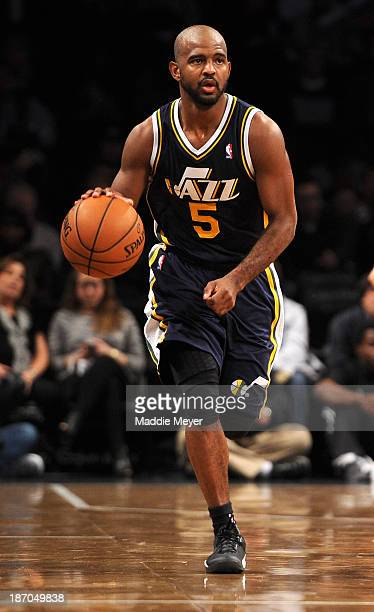 John Lucas III of the Utah Jazz carries the ball down court during the second half against the Brooklyn Nets at Barclays Center on November 5, 2013...