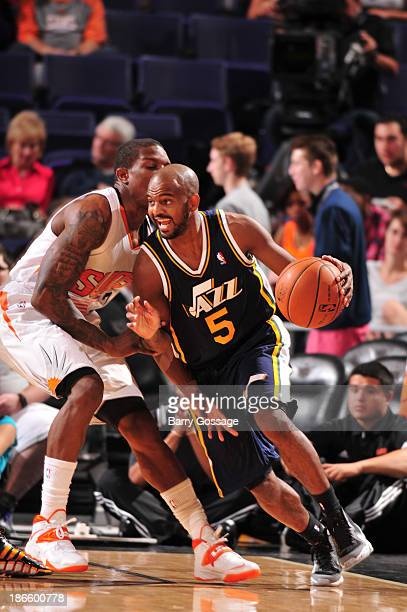 John Lucas III of the Utah Jazz drives against Eric Bledsoe of the Phoenix Suns on November 1, 2013 at U.S. Airways Center in Phoenix, Arizona. NOTE...