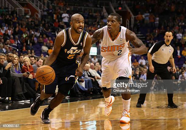 John Lucas III of the Utah Jazz drives against Eric Bledsoe of the Phoenix Suns during the NBA game at US Airways Center on November 1, 2013 in...