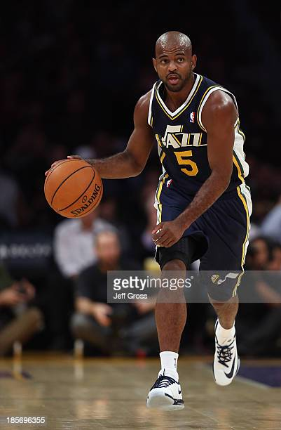 John Lucas III of the Utah Jazz drives down the court against the Los Angeles Lakers at Staples Center on October 22, 2013 in Los Angeles,...