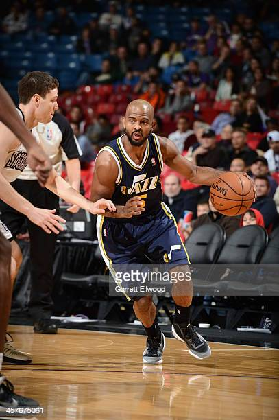 John Lucas III of the Utah Jazz drives to the basket against the Sacramento Kings at Sleep Train Arena on December 11 2013 in Sacramento California...