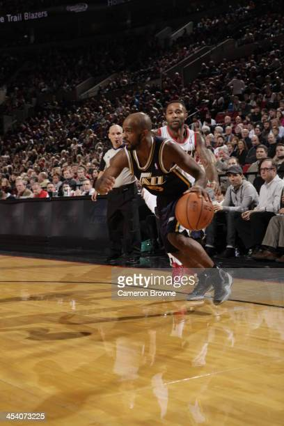 John Lucas III of the Utah Jazz drives to the basket against the Portland Trail Blazers on December 6 2013 at the Moda Center Arena in Portland...