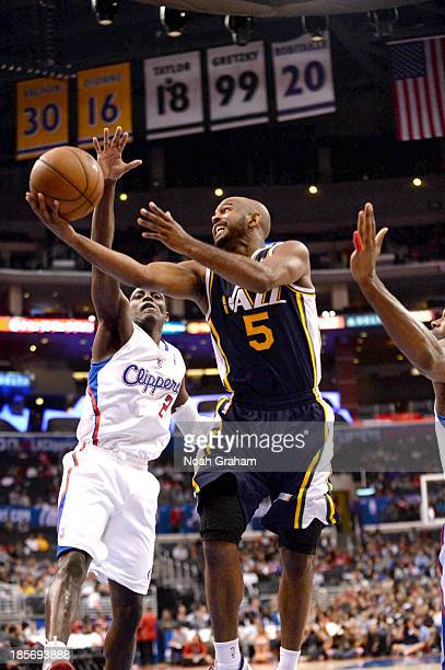 John Lucas III of the Utah Jazz goes up for a shot against Darren Collison of the Los Angeles Clippers at Staples Center on October 23, 2013 in Los...