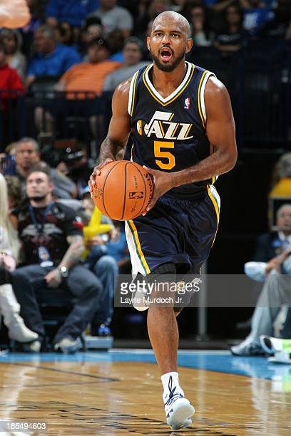 John Lucas III of the Utah Jazz pushes the ball up the floor against the Oklahoma City Thunder during an NBA preseason game on October 20 2013 at the...