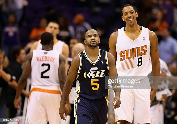 John Lucas III of the Utah Jazz reacts as he walks off the court past Channing Frye of the Phoenix Suns following the NBA game at US Airways Center...
