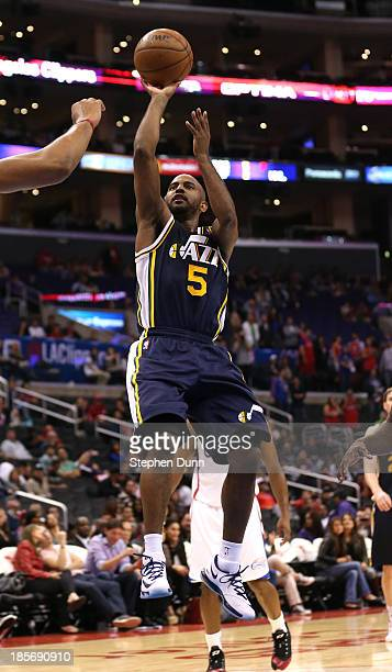 John Lucas III of the Utah Jazz shoots against the Los Angeles Clippers at Staples Center on October 23, 2013 in Los Angeles, California. The...