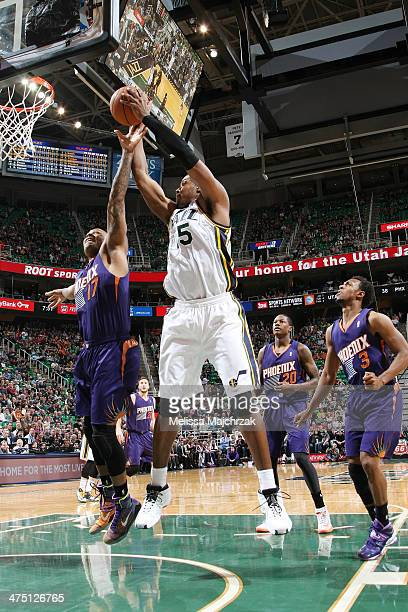John Lucas III of the Utah Jazz shoots against the Phoenix Suns at EnergySolutions Arena on February 26, 2014 in Salt Lake City, Utah. NOTE TO USER:...