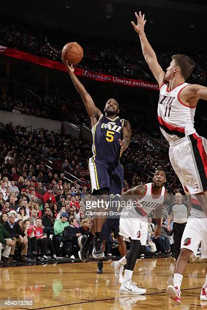 John Lucas III of the Utah Jazz shoots against the Portland Trail Blazers on December 6 2013 at the Moda Center Arena in Portland Oregon NOTE TO USER...