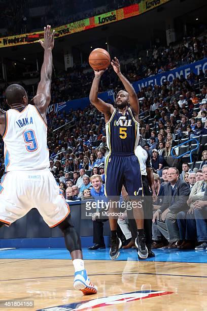 John Lucas III of the Utah Jazz takes a three pointer against the Oklahoma City Thunder on November 24, 2013 at the Chesapeake Energy Arena in...