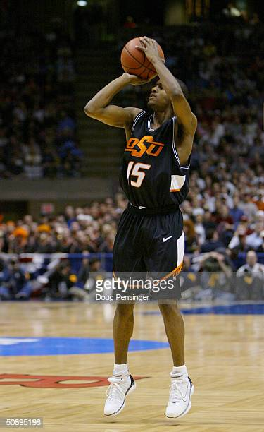 John Lucas of the Oklahoma State Cowboys shoots a jumper during their Elite 8 game of the NCAA Division I Men's Basketball Tournament against the St....