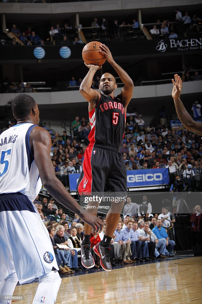 John Lucas #5 of the Toronto Raptors takes a shot against the Dallas Mavericks on November 7, 2012 at the American Airlines Center in Dallas, Texas.