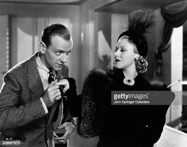 John Lucky Garnett leans in to kiss the hand of Penelope Penny Carroll in Swing Time
