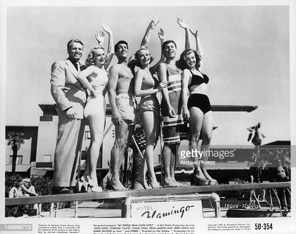 John Lund Marie Wilson Dean Martin Diana Lynn Jerry Lewis and Corinne Calvet waving from Flamingo diving board in a scene from the film 'My Friend...