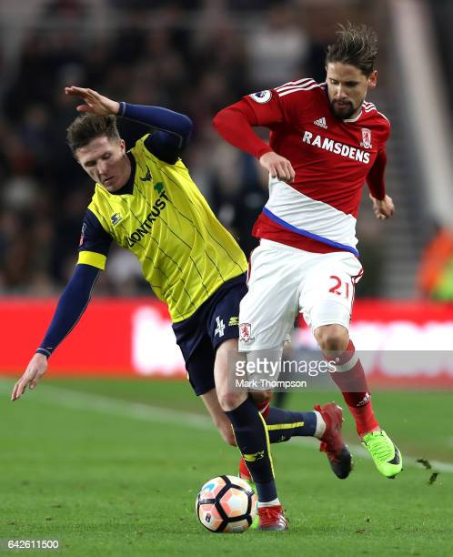 John Lundstram of Oxford United and Gaston Ramirez of Middlesbrough battle for possession during The Emirates FA Cup Fifth Round match between...