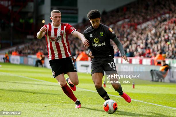 John Lundstram of Sheffield United and Jamal Lewis of Norwich City during the Premier League match between Sheffield United and Brighton Hove Albion...