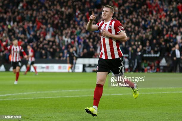 John Lundstram of Sheffield United celebrates after scoring his team's first goal during the Premier League match between Sheffield United and...
